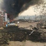 Smoke rises in a burned-out neighbourhood in Bonnyville, in this handout photo