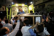 A coffin is carried out of an ambulance outside of the Coptic church that was bombed on Sunday in Tanta
