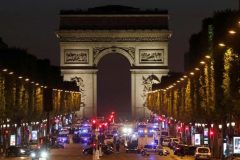 Police secure the Champs Elysees Avenue after one policeman was killed and another wounded in a shooting incident in Paris