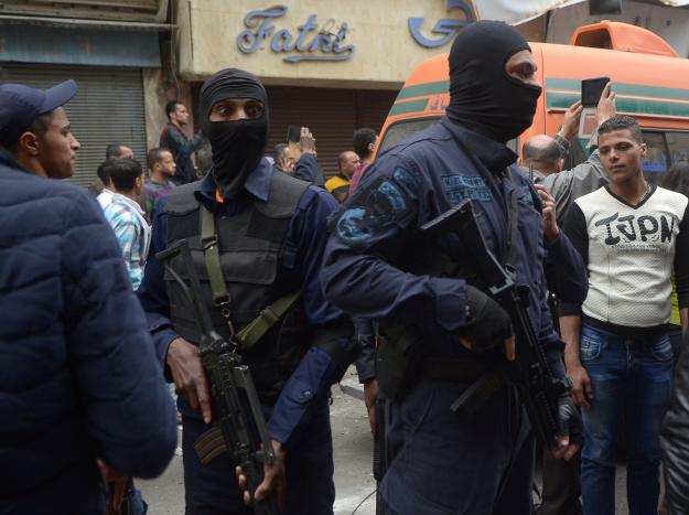 Egypt's special forces members take position after an attack by a suicide bomber in front of a church in Alexandria