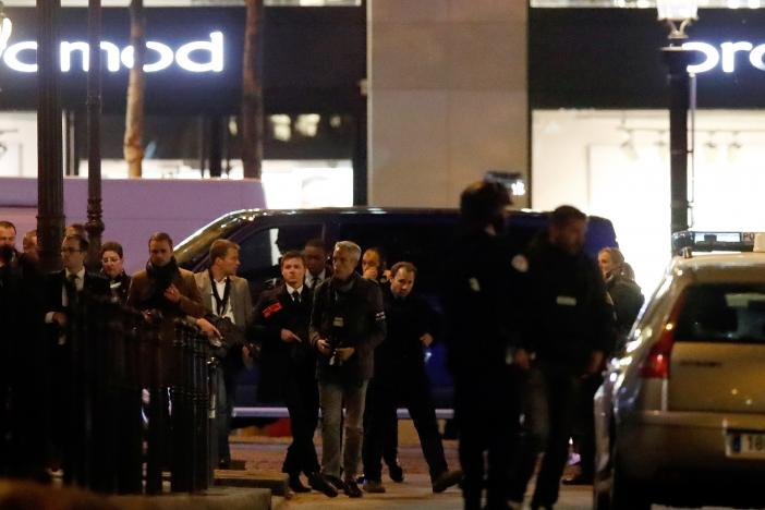 Police conduct an investigation near the Champs Elysees Avenue after a shooting incident in Paris