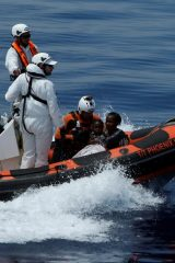 Migrants are brought to the Malta-based NGO Migrant Offshore Aid Station ship Phoenix during a rescue operation in the central Mediterranean off the Libyan coastal town of Sabratha