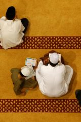Muslims wait to perform tarawih prayers to mark the start of Ramadan at a mosque in Singapore