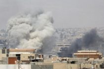 Smoke billows after an air strike by Iraqi forces towards the positions of the Islamic State militants in the Old City of Mosul
