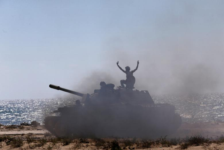 A tank belonging to special forces of the Libyan army enter the area of clashes with Islamist militants in their last stronghold in Benghazi