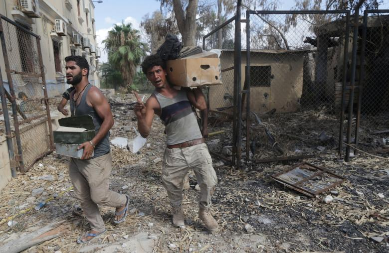 Members of Libyan National Army (LNA) carry ammunition during clashes with Islamist militants in the militants' last stronghold in Benghazi