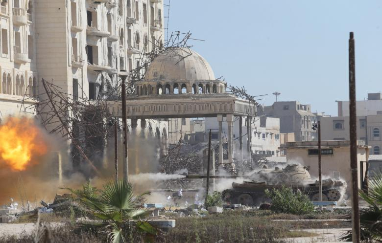 A tank belonging to special forces from the Libyan army clashes with Islamist militants in their last stronghold in Benghazi