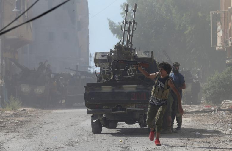 Member of the Libyan army's special forces fires a weapon during clashes with Islamist militants in Benghazi