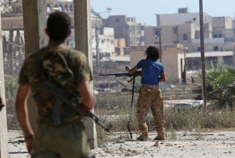 Members of the Libyan army's special forces clash with Islamist militants in their last stronghold in Benghazi, Libya