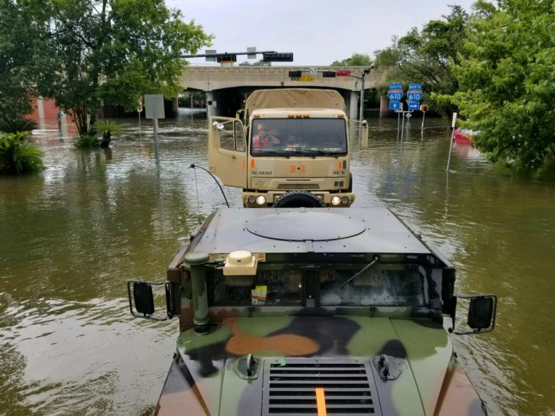 Handout photo of Texas National Guard soldiers arriving in vehicles to aid residents in heavily flooded areas from the storms of Hurricane Harvey in Houston