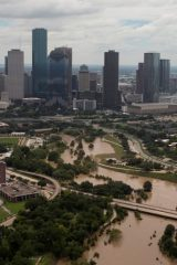 The Houston skyline is seen in the background as Buffalo Bayou is seen flooded from Tropical Storm Harvey in Texas, U.S.