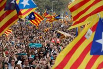 People gather as they watch on giant screens a plenary session outside the Catalan regional parliament in Barcelona
