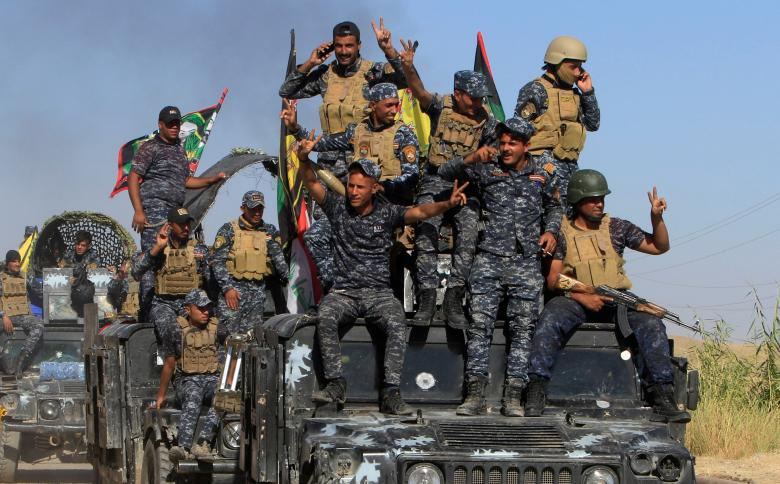 Members of Iraqi federal forces are seen in Dibis area on the outskirts of Kirkuk