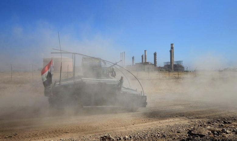 A military vehicle of Iraqi federal forces enters oil fields in Kirkuk