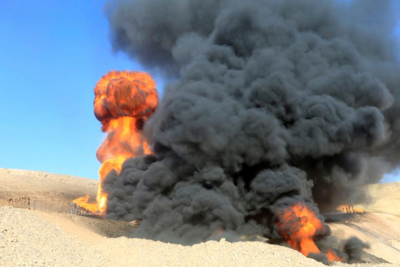 Smoke rises from oil wells, in Dibis area on the outskirts of Kirkuk