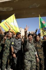 "Fighters of Syrian Democratic Forces gesture the ""V"" sign in Raqqa"