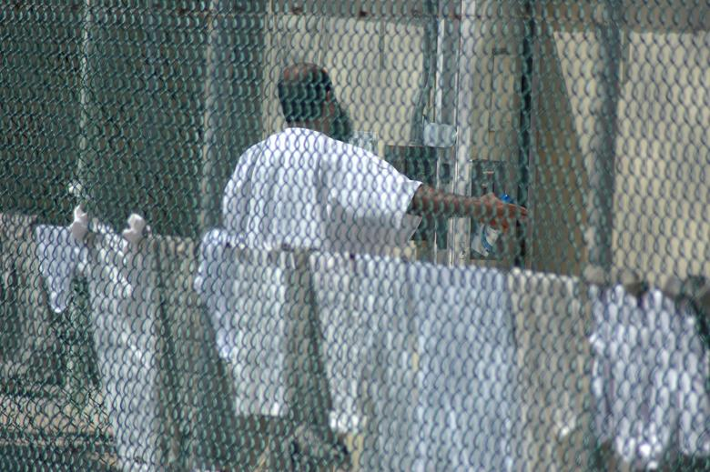 Inmate gestures outside his cell at the U.S. Naval Base at Guantanamo Bay
