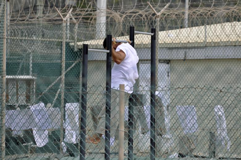 A Guantanamo detainee does pull-ups inside an exercise area at the detention facility at Guantanamo Bay U.S. Naval Base