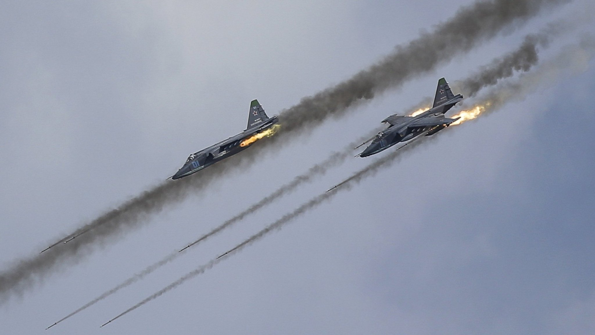 Russian Sukhoi Su-25 Frogfoot ground-attack planes perform during the Aviadarts military aviation competition at the Dubrovichi range near Ryazan, Russia