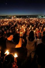 People attend a candlelight vigil the day after a shooting at Marjory Stoneman Douglas High School in Parkland