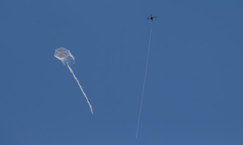 Israeli drone tries to down a kite flown by demonstrators during a protest where Palestinians demand the right to return to their homeland, at the Israel-Gaza border, east of Gaza City